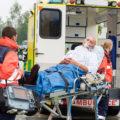 Injured man getting into ambulance